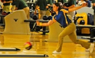 Girl Bowling on Bowling Lane