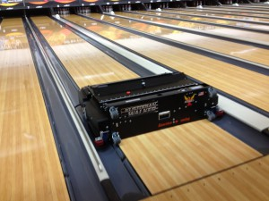 picture of lane oiling machine for rental bowling shoes