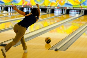 A Good Bowling Arm Swing - Picture Of a Girl Bowling