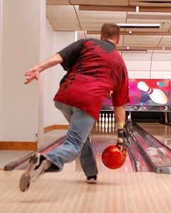 Man Releasing Bowlingball Using Wrist Support