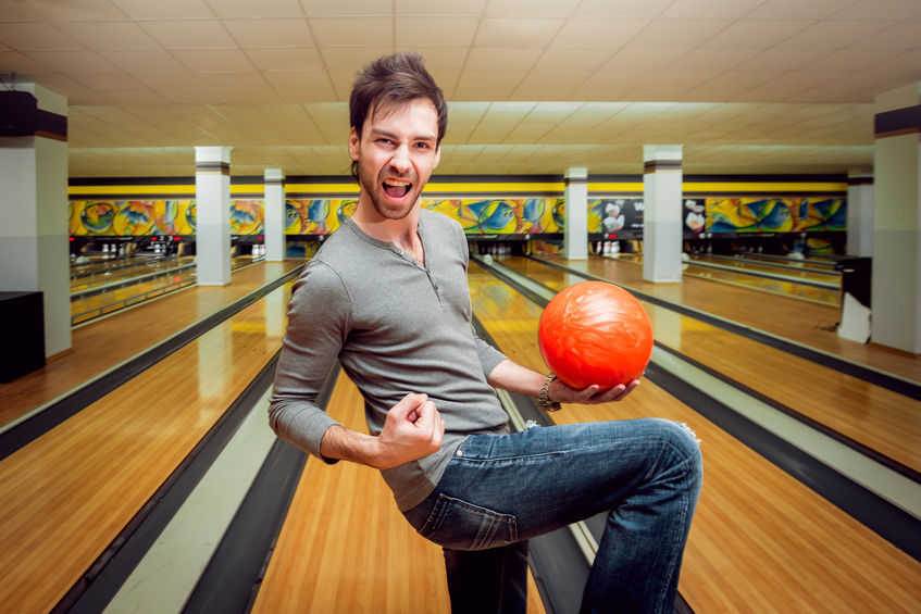 Man On A Bowling Lane Holding A bowling Ball For The Best Bowling Ball To Use Article